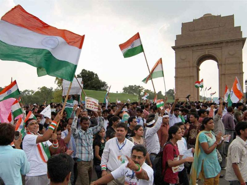 Anna Hazare supporters take part in a protest march from India Gate to Jantar Mantar in New Delhi.