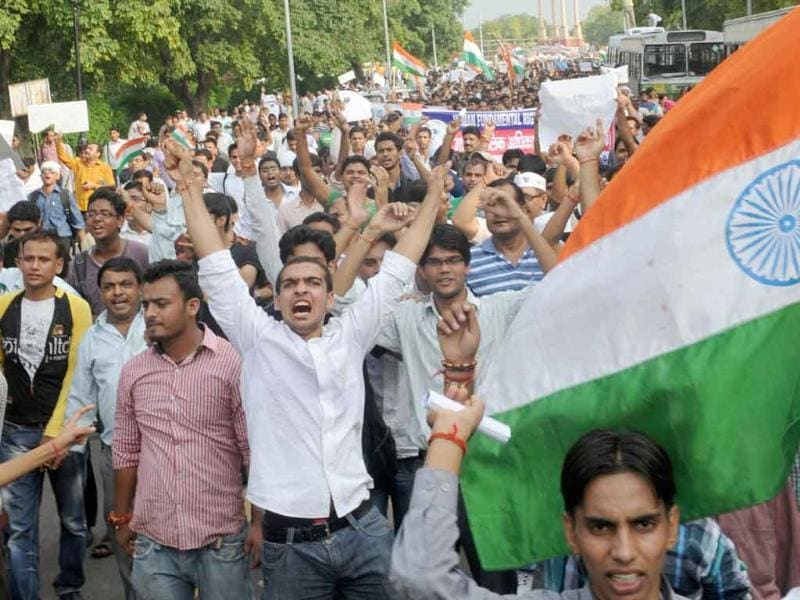 Thousands people shout anti-government slogans as they march from India Gate to Parliament street during a rally in support of social activist Anna Hazare in New Delhi.