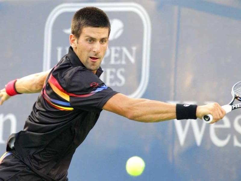 Novak Djokovic from Serbia eyes a backhand return against Ryan Harrison during a match at the Western & Southern Open tennis tournament in Mason, Ohio.