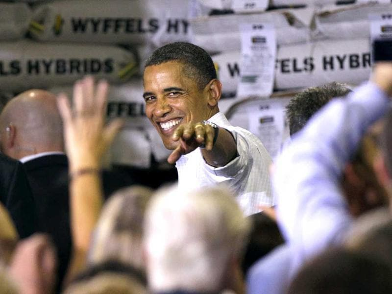 US President Barack Obama waves as he leaves a town hall meeting at Wyffels Hybrids Inc. seed company in Atkinson, Ill.