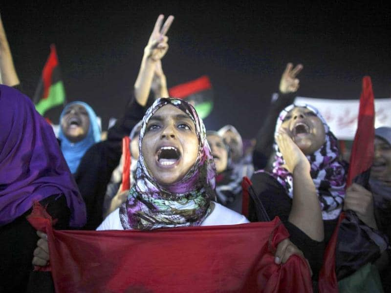 Women take part in a demonstration to celebrate the recent advances in the battle front and the six-month anniversary of the uprising against Libyan leader Muammar Gaddafi's regime at the rebel-held town of Benghazi, Libya.