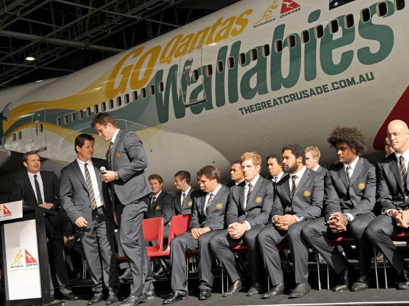 Australian Wallabies rugby team players pose in front of a Qantas boeing 747 plane during the announcement, in Sydney, of Australia's squad for the 2011 Rugby World Cup.