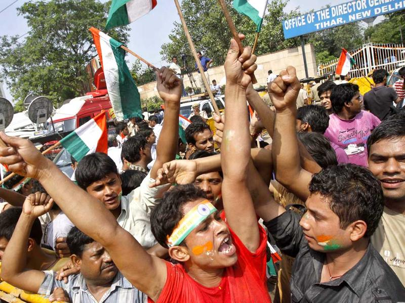 Supporters of Anna Hazare shout slogans outside Tihar prison, where Hazare is presently lodged, in New Delhi Thursday.
