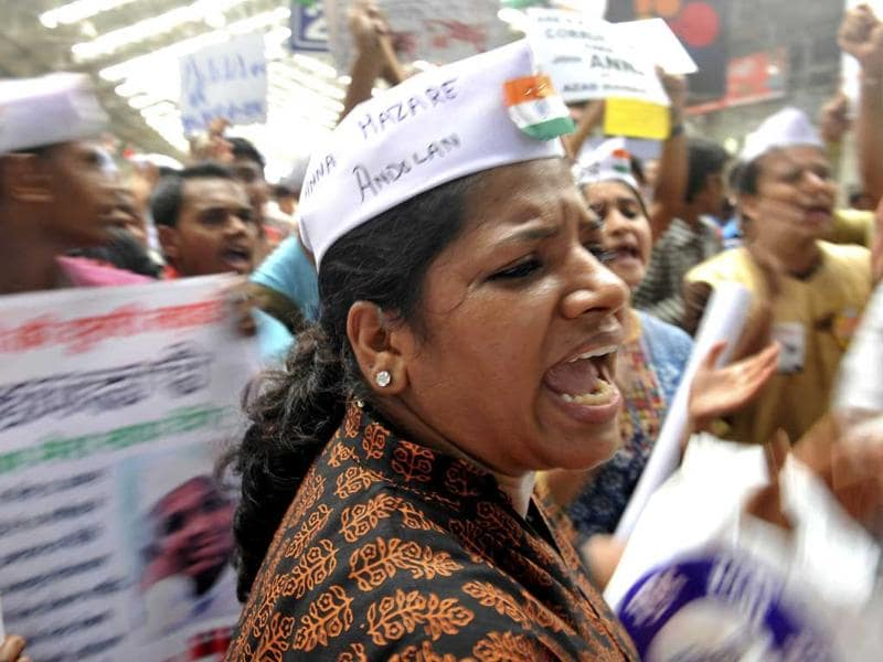 A lady who skipped office in support of Anna Hazare sings a patriotic song during a protest site in Mumbai.