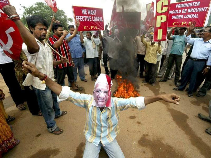 A supporter of Anna Hazare wears a mask of Hazare and shouts slogans in Bhubaneshwar.