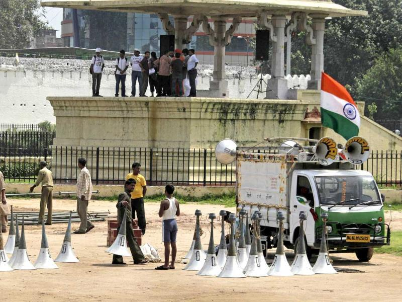 Laborers prepare the venue for a public protest by anti-corruption activist Anna Hazare at a fairground in New Delhi.