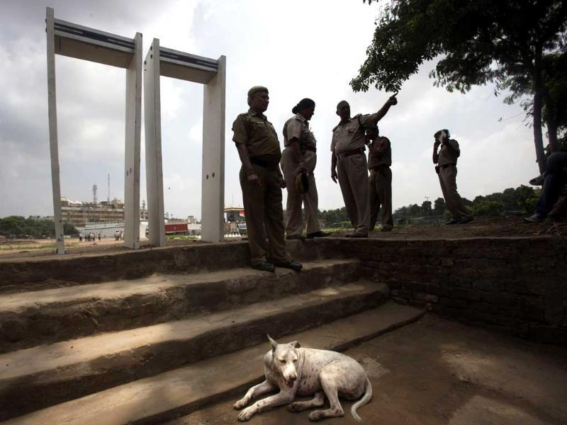 Delhi policemen stand near metal detectors as they prepare for a public protest headed by anti-corruption activist Anna Hazare in New Delhi.