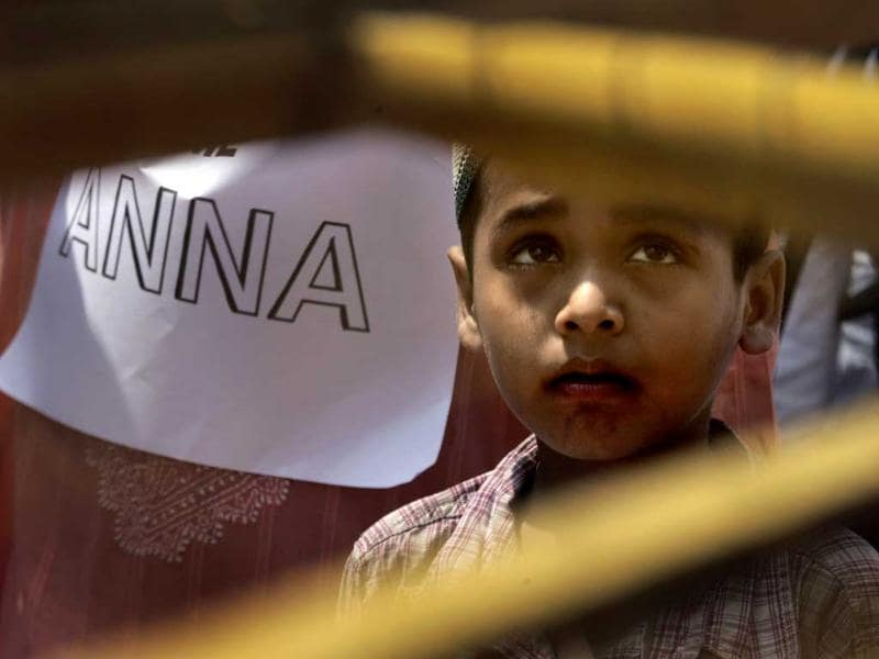 A young supporter stands at the venue for a public protest headed by anti-corruption activist Anna Hazare at a fairground in New Delhi.