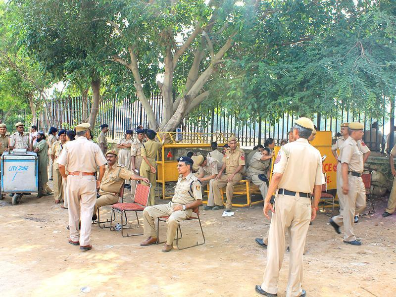 Delhi policemen rest under the shade at Ramlila Maidan in New Delhi.