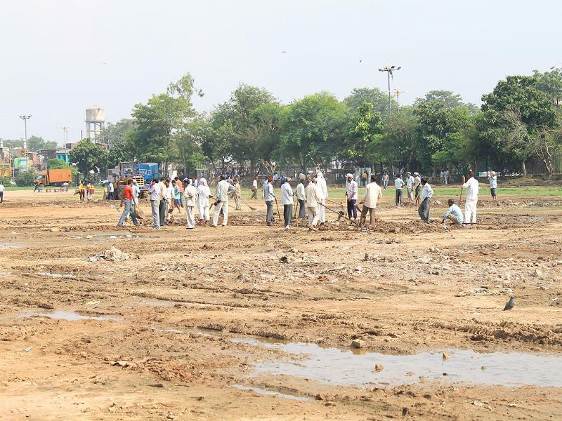 Labourers prepare the venue for a public protest by anti-corruption activist Anna Hazare at Ramlila Maidan New Delhi.