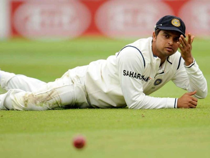 Suresh Raina gestures on the ground after the ball evaded him during the fourth cricket Test match against England at the Oval cricket ground in London.