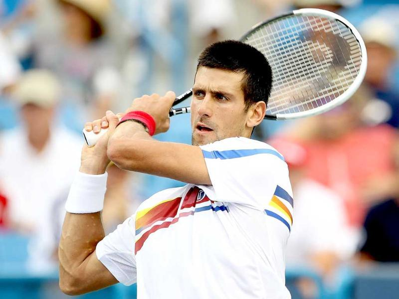 Novak Djokovic of Serbia returns a shot to Radek Stepanek of the Czech Republic during the Western & Southern Open at the Lindner Family Tennis Center in Mason, Ohio.