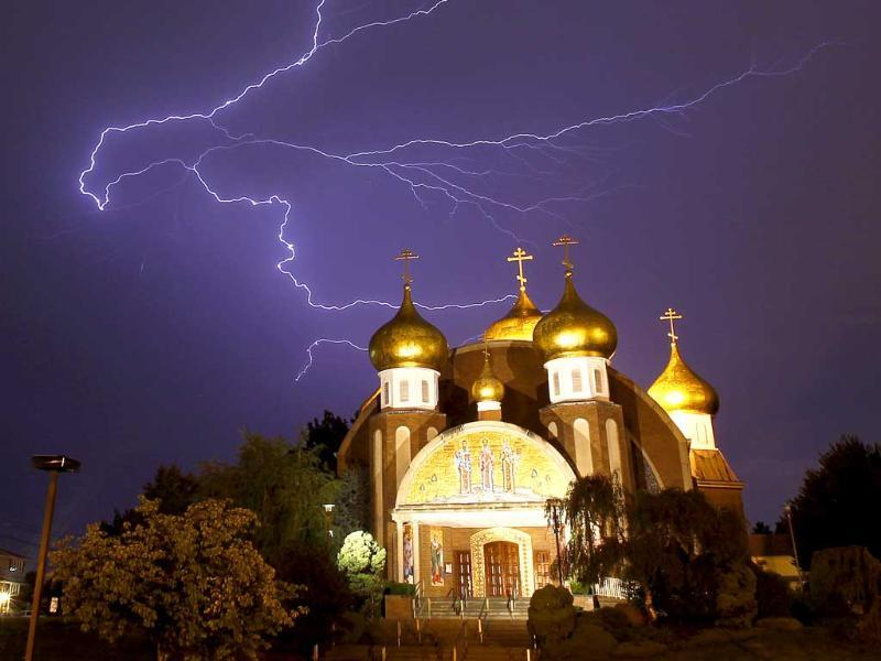 Lightning spreads across the sky over the Russian Orthodox Church of Three Saints in Garfield, New Jersey during a storm.
