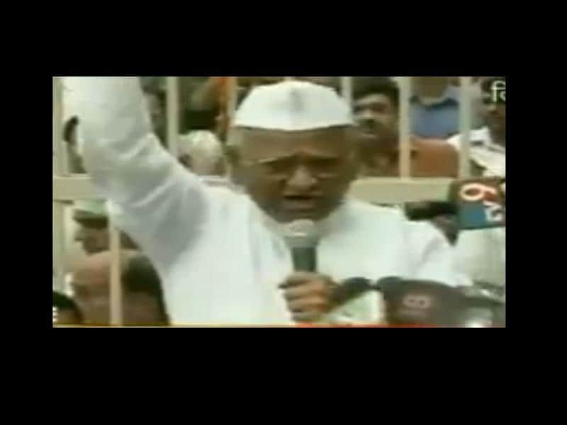 A TV grab shows Anna Hazare addressing a gathering after he came out of Tihar Jail in New Delhi.