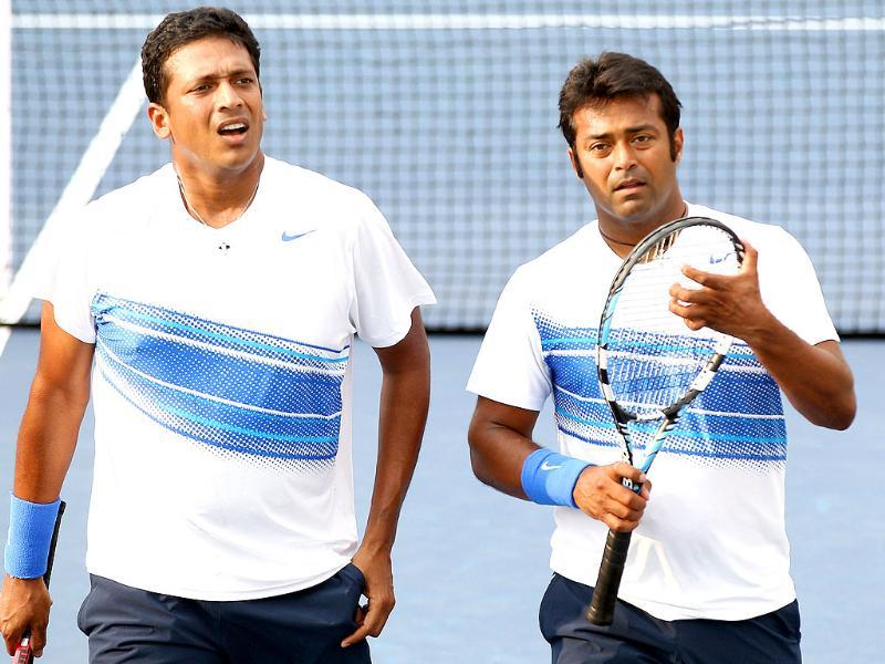 India's doubles team of Mahesh Bhupathi and Leander Paes talk in between games of their match against Marc Lopez and Rafael Nadal of Spain during the Western & Southern Open in Mason, Ohio.
