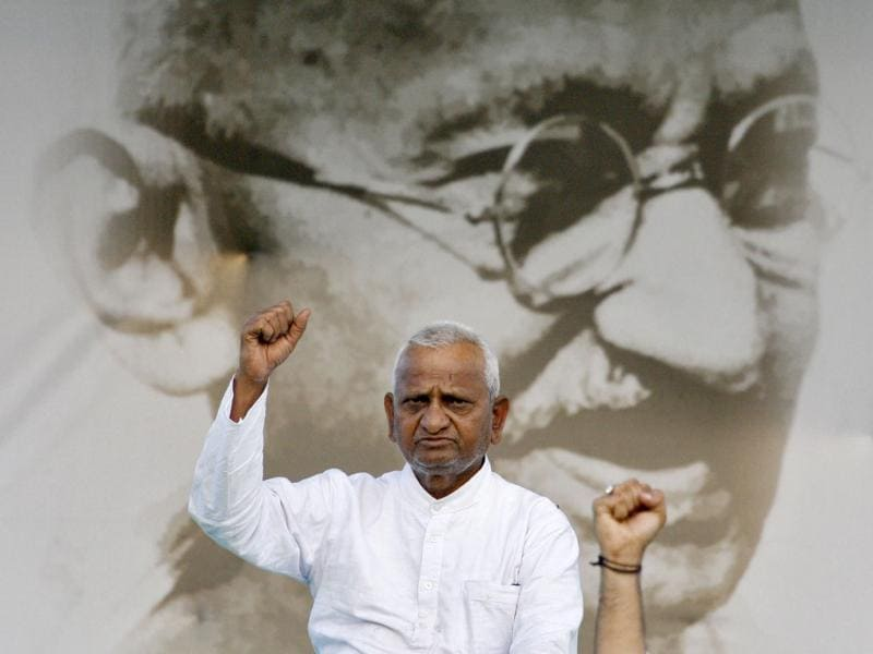 Veteran Indian social activist Anna Hazare raises his fist in front of a portrait of Mahatma Gandhi at Ramlila grounds in New Delhi. A vast and jubilant crowd cheered as Gandhian activist Hazare walked out of jail in New Delhi to carry on a hunger strike in public, the latest act in a drama of popular fury over corruption that has put India's government in a bind.