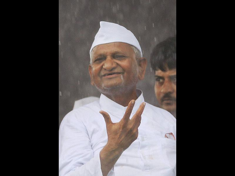 Social activist Anna Hazare gestures at Ram Lila Grounds in New Delhi.