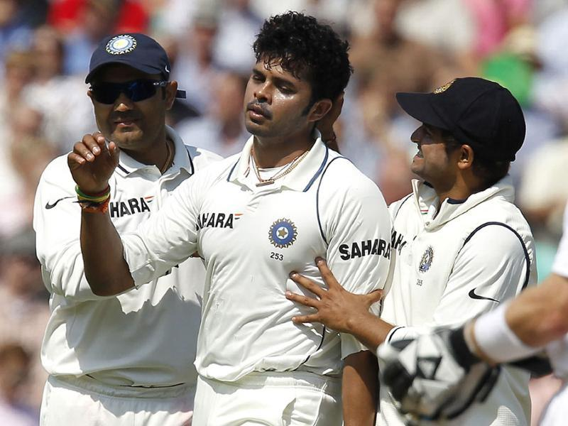 Sreesanth is congratulated by Virender Sehwag and Suresh Raina after taking the wicket of England's captain Andrew Strauss on the second day of the fourth test match in London.
