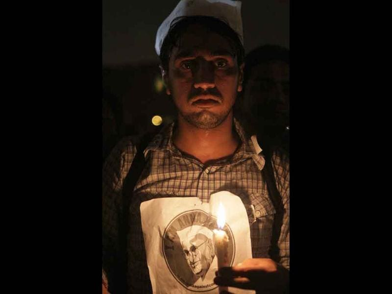 A supporter of Anna Hazare during candle light vigil at Ramlila ground in New Delhi.