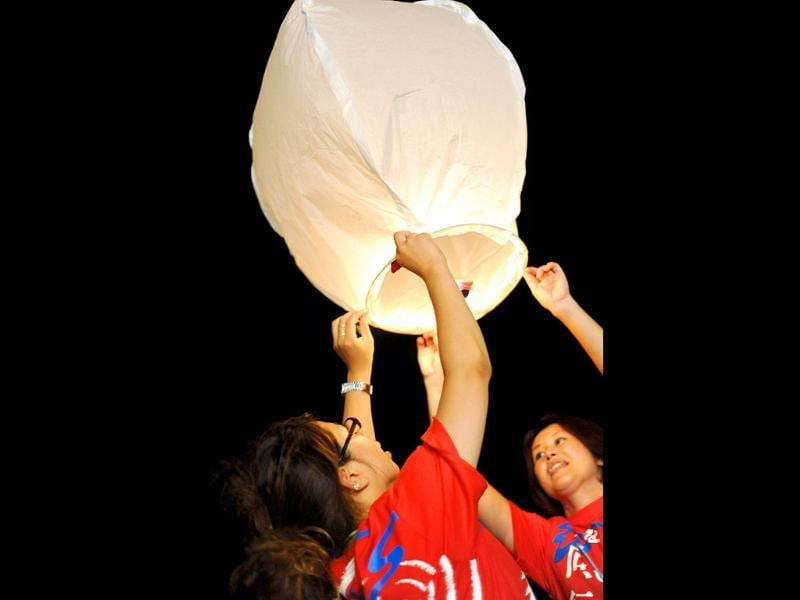 Participants flying paper lanterns during a tsunami related charity event in Jimbaran on Indonesia's resort island of Bali. Prayers were held for the victims of the March 11 earthquake and tsunami disaster in Japan.