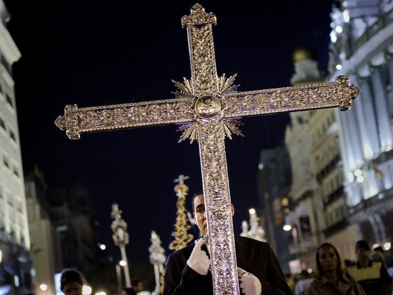 A man holds a cross during a procession after a religious ceremony celebrated with the Pope Benedict XVI in Madrid.