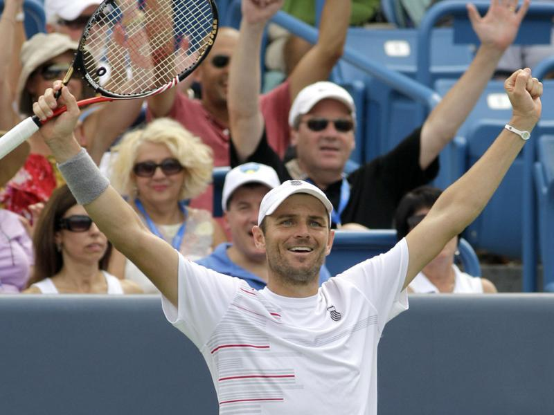 Mardy Fish celebrates after he defeated Rafael Nadal 6-3, 6-4, in a quarterfinal match at the Western & Southern Open tennis tournament in Mason, Ohio.