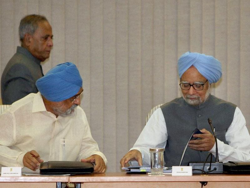 Prime Minister Manmohan Singh with deputy chairman of Planning Commission Montek Singh Ahluwalia chairs the full Planning Commission meeting to consider the draft approach paper for the Twelfth Five Year Plan in New Delhi.