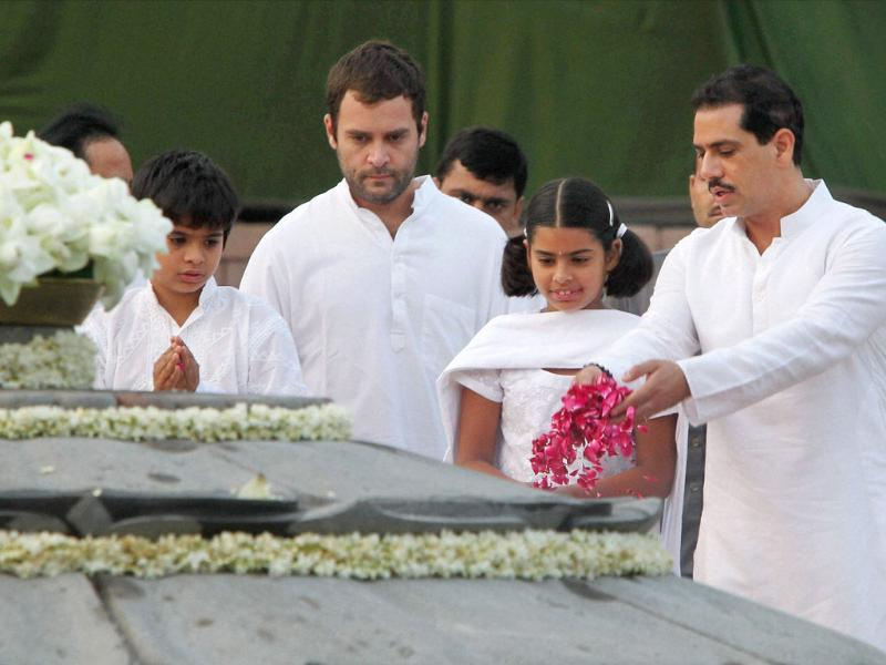 Congress general secretary Rahul Gandhi, Robert Vadra and his children pay tribute to former prime minister Rajiv Gandhi on his 67th birth anniversary at Vir Bhumi in New Delhi.
