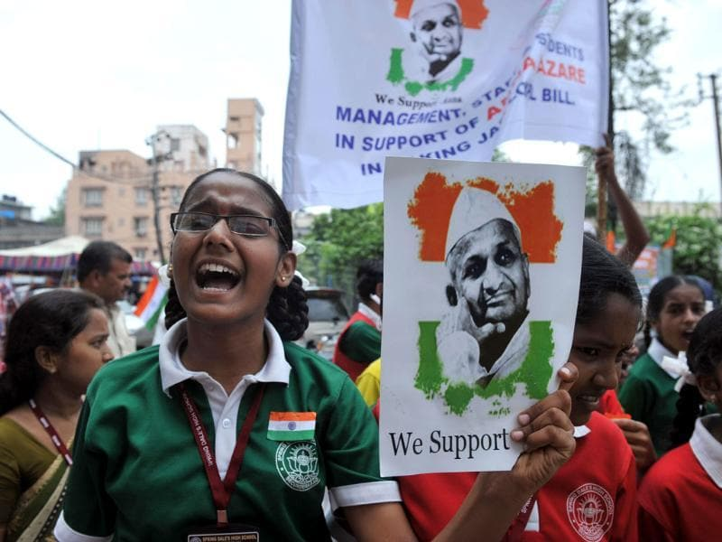 Schoolgirls participate in a rally in Hyderabad to support social activist Anna Hazare's fast.