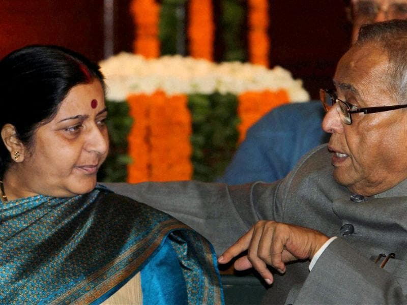 Union finance minister Pranab Mukherjee is seen with Leader of Opposition in the Lok sabha Sushma Swaraj during a function to commemorate 67th birth anniversary of former prime minister late Rajiv Gandhi in Central Hall of Parliament in New Delhi.