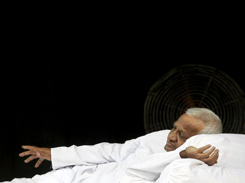 Anna Hazare lies down on the stage during his hunger strike in New Delhi.