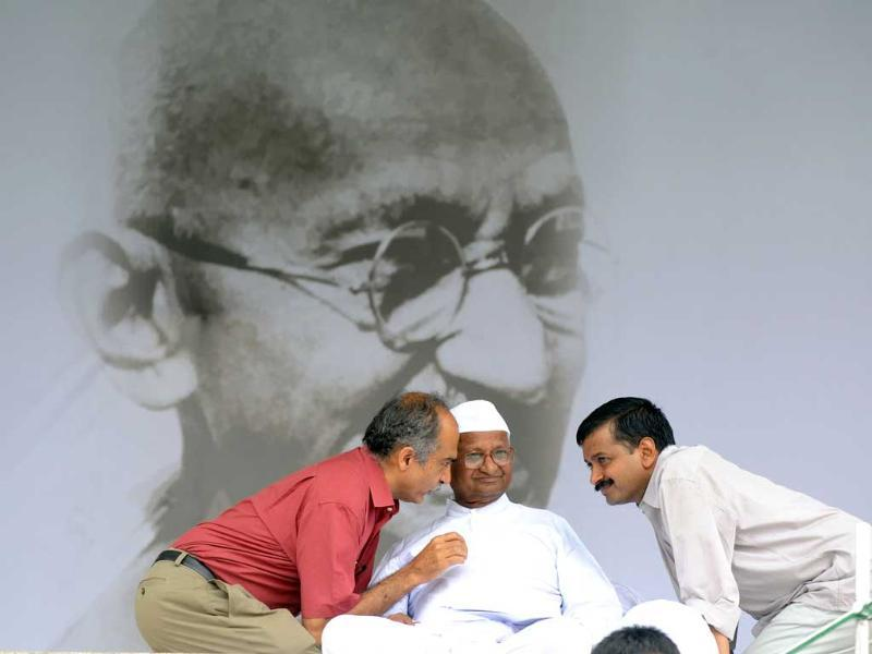 Supporters speak with Anna Hazare during his hunger strike at Ramlila Grounds in New Delhi.