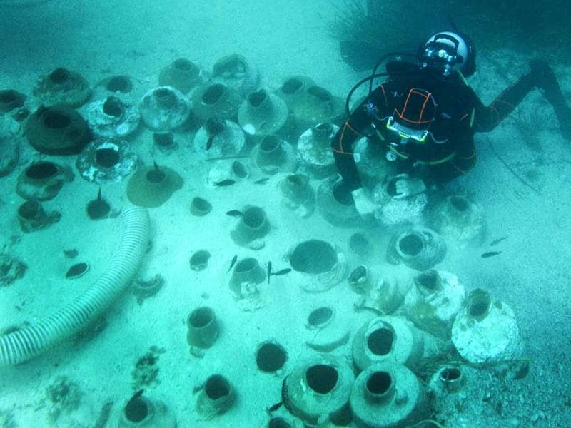 A diver pushes Roman ancient amphoras down onto sand off the coast of the Frioul island, southern France. Discovered in 1952 by French undersea explorer Commander Jacques-Yves Cousteau and the Calypso team during the excavations of the