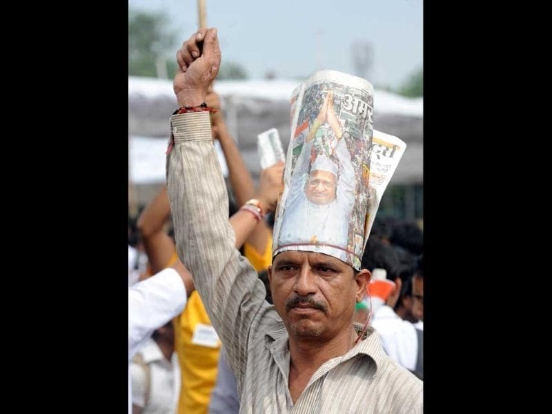 A supporter of Anna Hazare shouts slogans during his hunger strike at Ramlila Grounds in New Delhi.
