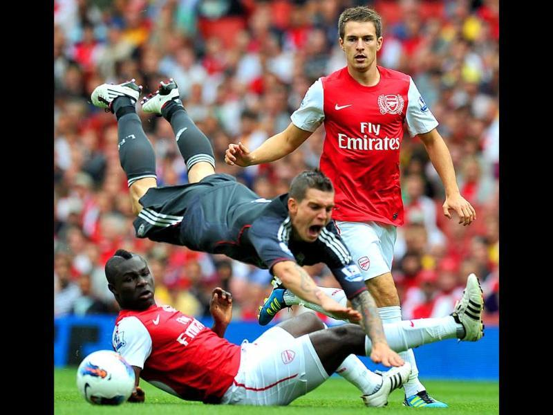 Arsenal midfielder Aaron Ramsey (R) looks on as Liverpool defender Daniel Agger vies with Arsenal midfielder Emmanuel Frimpong (L) during their English Premier League football match in north London, Engand.