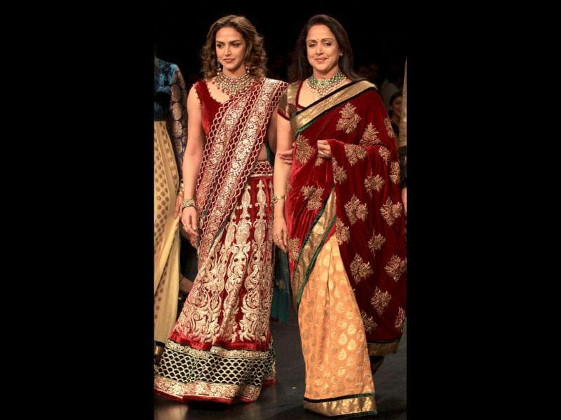 Hema Malini and daughter Esha Deol walk the ramp displaying a design by Shyamal and Bhumikaon on the third day of Lakme Fashion Week (LFW) Winter/Festive 2011 in Mumbai. The LFW, held twice annually, features creations by over 60 designers and will culminate with a grand finale on August 21.