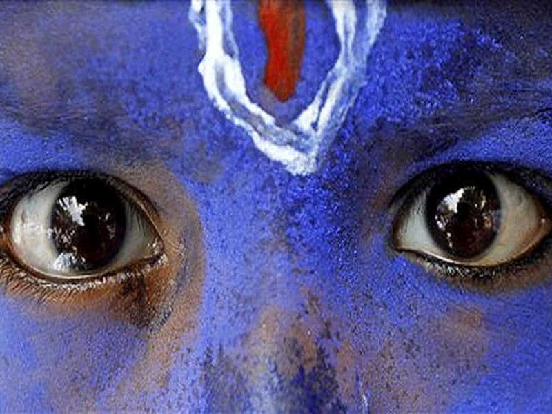 A schoolboy, dressed as Lord Krishna, participates in a rally in support of anti-corruption activist Anna Hazare, in Allahabad. The activist on a hunger strike that sparked a popular campaign against corruption said that he was feeling physically weak but resolved in his demand that the government adopt his version of a bill setting up an anti-graft watchdog.