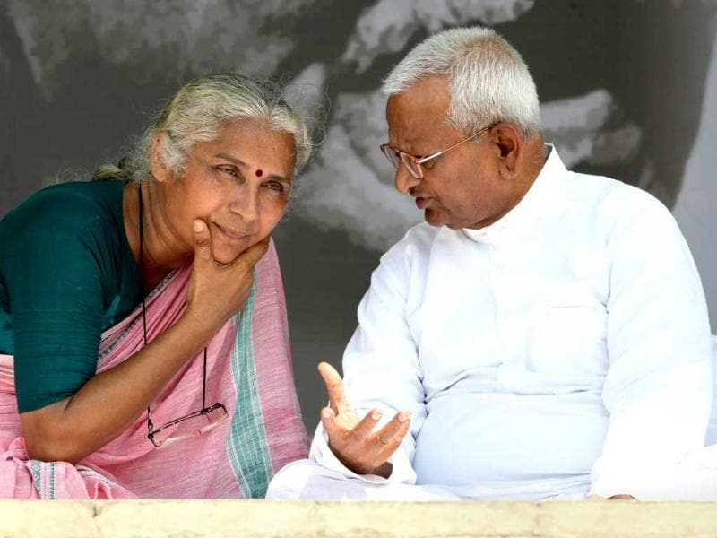 Social activist Anna Hazare chats with Medha Patkar during their protest against corruption at the Ramlila Ground in New Delhi.