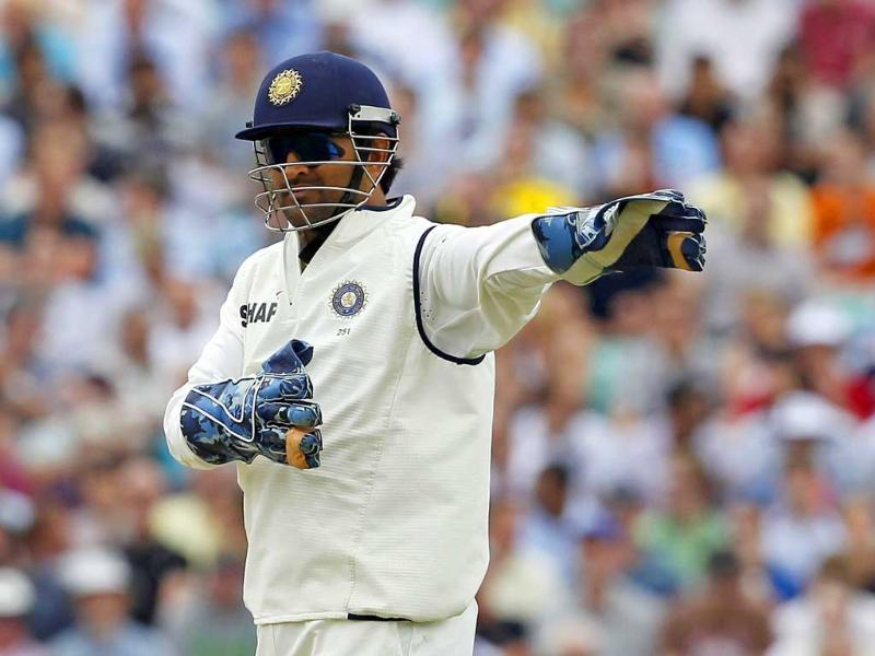 Wicketkeeper Mahendra Singh Dhoni gestures during day 3 of the fourth Test match between England and India at The Oval Cricket Ground in London.
