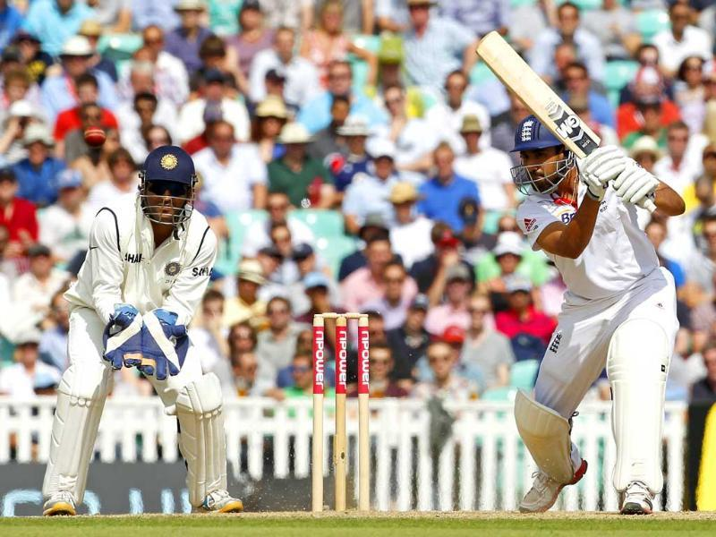 Ravi Bopara plays a shot watched by India's captain and wicketkeeper Mahendra Singh Dhoni during day 3 of the fourth Test match between England and India at The Oval Cricket Ground in London.