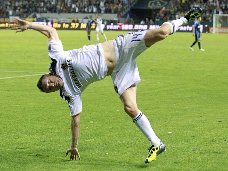Los Angeles Galaxy's Robbie Keane of Ireland cartwheels after scoring against the San Jose Earthquakes during their MLS soccer match in Carson, California.