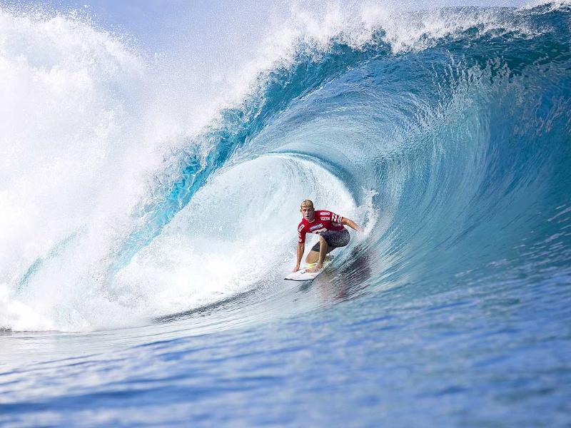 In this image released by the Association of Surfing Professionals, Mick Fanning, of Australia, rides a wave during a round 1 heat at the Billabong Pro surfing competition in Teahupo'o, Tahiti.