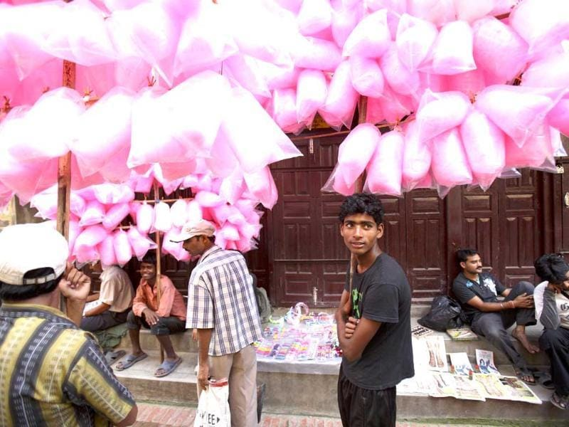 A street vendor selling cotton candy waits for customers during the Krishna Janmashtami festival in Lalitpur near Kathmandu.