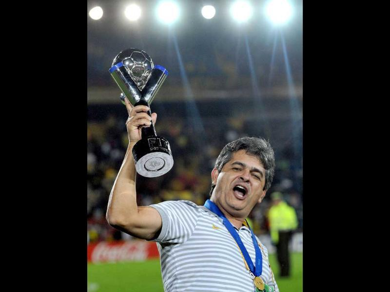 Brazil's coach Franco Ney celebrates with the trophy at the end of the FIFA 2011 Under-20 World Cup final match against Portugal in Bogota. Brazil won 3-2 in overtime.