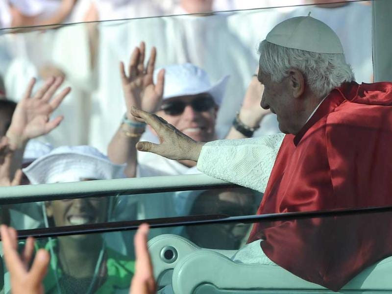 Pope Benedict XVI arrives to celebrate a mass on a vast dusty esplanade outside Madrid during the World Youth Day (WYD) festivities.