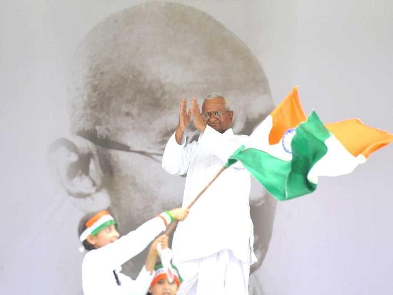 A supporter of Anna Hazare waves the national flag as he acknowledges the crowd during Hazare's anti-corruption hunger strike at Ramlila Maidan in New Delhi.