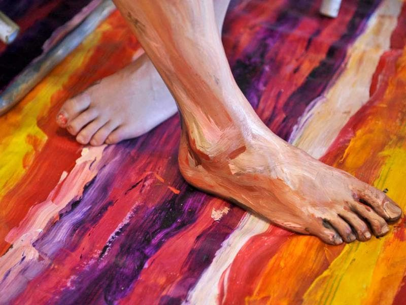 A comparison Alexa Meade and Will Claybaugh's feet after Alexa painted Will during a performance at the Irvine Contemporary gallery in Washington.