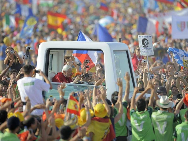 Pope Benedict XVI waves to faithful from his popemobile as he arrives to celebrate a mass on a vast dusty esplanade outside Madrid during the World Youth Day (WYD) festivities.