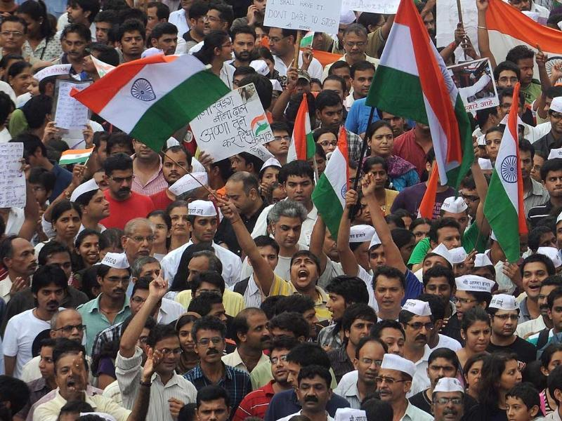 Citizens wave the national flag and hold placards as they take part in a rally in support of social activist Anna Hazare in Mumbai.