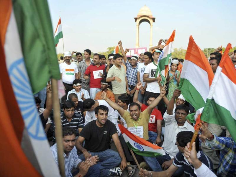 Supporters of anti-corruption activist Anna Hazare shout slogans during a rally at India Gate in New Delhi.